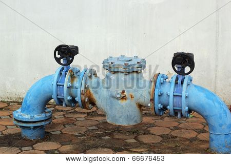 Blue Rusty Metal Industrial Water Pipes With A Valve.