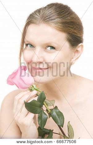 Attractive Mid Adult Woman With A Pink Rose , Female Face Of Beautiful Caucasian