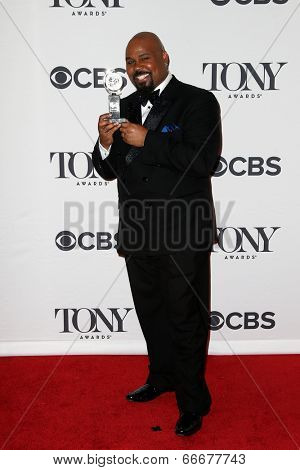 NEW YORK-JUNE 8: Actor James Monroe Iglehart poses in the press room at the American Theatre Wing's 68th Annual Tony Awards at Radio City Music Hall on June 8, 2014 in New York City.
