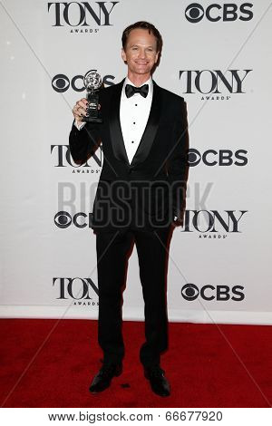 NEW YORK-JUNE 8: Actor Neil Patrick Harris poses in the press room at the American Theatre Wing's 68th Annual Tony Awards at Radio City Music Hall on June 8, 2014 in New York City.