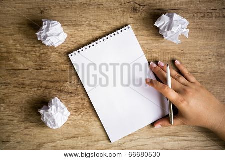 Blank paper waiting for idea with hand and pen