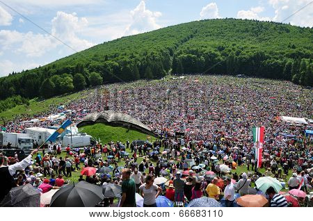 Crowd Of Religious Pilgrims People During A Catholic Celebration