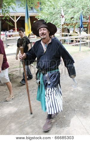MUSKOGEE, OK - MAY 24: A man dressed as a prince pirate stops to talk during the Oklahoma 19th annual Renaissance Festival on May 24, 2014 at the Castle of Muskogee in Muskogee, OK.