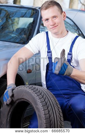 Mechanic With A Tire