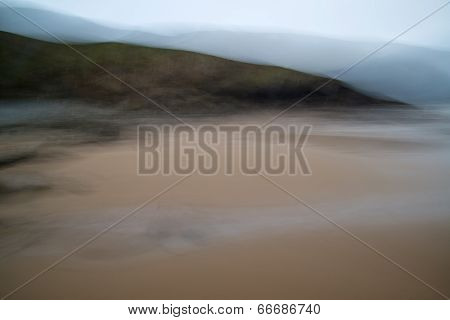 Deliberate Motion Blur Artistic Effect Filter On Beach Landscape Image