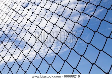 metallic net with blue sky background