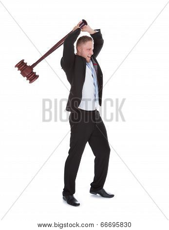 Businessman Wielding A Big Wooden Mallet