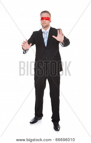 Stylish Young Businessman Wearing A Red Blindfold