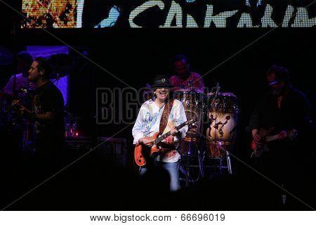 ATLANTIC CITY, NJ - JUNE 13: Musician Carlos Santana performs with his band at The Borgata Hotel & Casino on June 13, 2014 in Atlantic City, NJ.