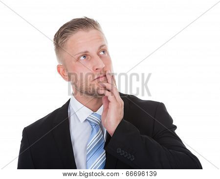 Businessman Standing Deep In Thought