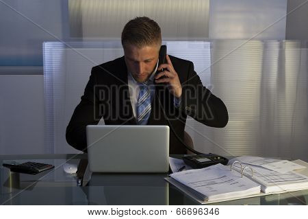 Stressed Businessman Working Late Into The Night