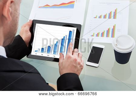 Businessman Analysing A Graph On A Tablet