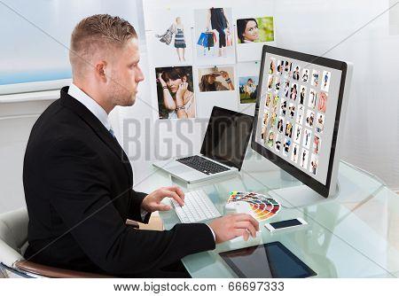 Businessman Editing Photographs