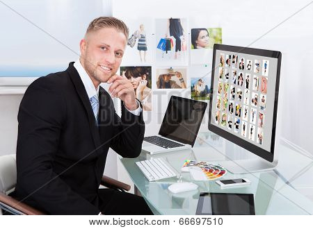 Businessman Editing Photographs