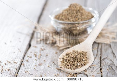 Dried Aniseed On A Wooden Spoon