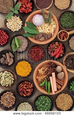 Large herb and spice selection in bowls.