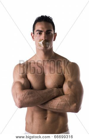 Muscular Shirtless Young Man With Duct Tape On Mouth Cannot Speak