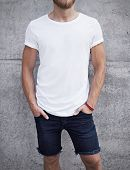 stock photo of casual wear  - Young man wearing white blank t - JPG
