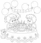 foto of kiddie  - Little girls and boy having fun at the holiday table with a birthday cake with candles - JPG