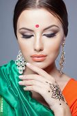 stock photo of sari  - fashion portrait of beautiful woman in indian sari - JPG