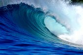 stock photo of blue  - Blue surfing wave breaking on tropical island reef - JPG