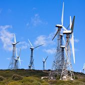 stock photo of tarifa  - Wind turbines on the green hill - JPG