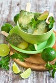 stock photo of popsicle  - Homemade lime and mint frozen popsicles - JPG
