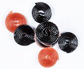 pic of meals wheels  - red and black licorice wheels on a white background - JPG