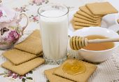 foto of buttermilk  - glass of buttermilk (milk) and cookies with honey ** Note: Shallow depth of field - JPG