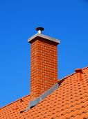 stock photo of gable-roof  - chimney in bright tile roof  with brick sunlight - JPG