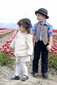 pic of mary jane  - A cute little boy and girl looking off across the tulip fields - JPG