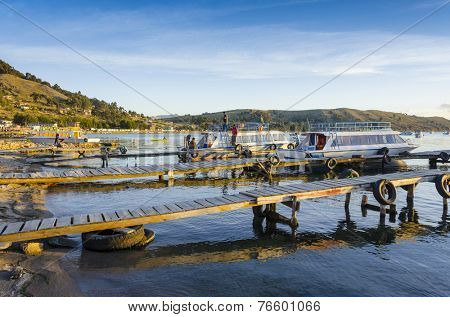 COPACABANA, BOLIVIA, MAY 6, 2014: People gather in port of Copacabana, Titicaca Lake
