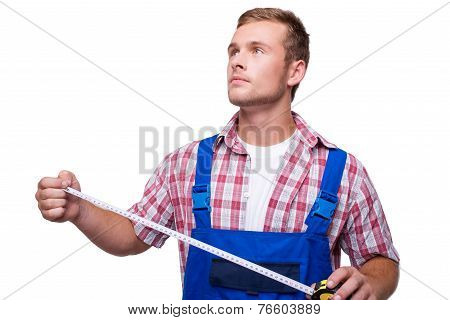 Young repairman with measurement