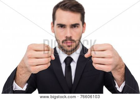 Exasperated businessman with clenched fists on white background
