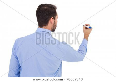 Rear view of a businessman writing with marker on white background