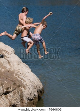 Adventurous Boys Jumping into Lake
