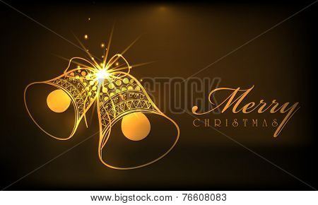 Beautiful shiny golden jingle bells on brown background for Merry Christmas celebrations.