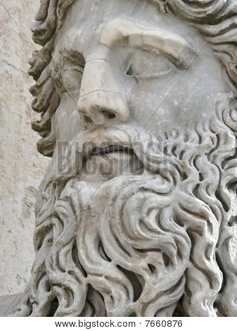 roman head carved in stone