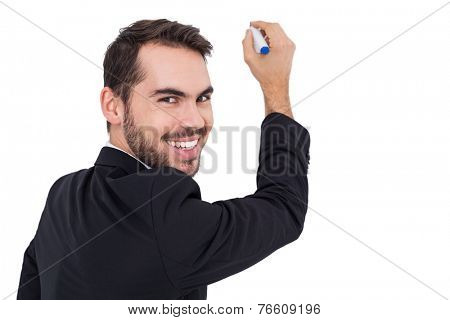 Happy businessman writing with marker on white background