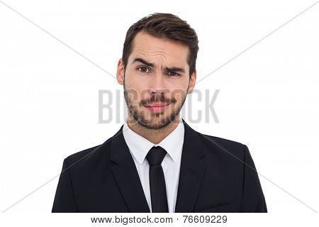 Portrait of a skeptical businessman well dressed on white background