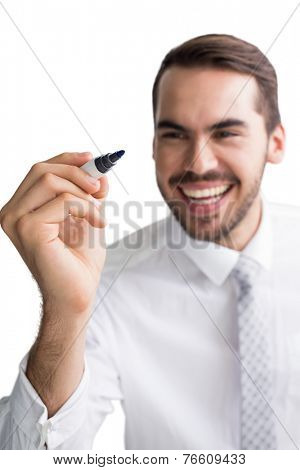 Happy businessman standing and writing with marker on white background