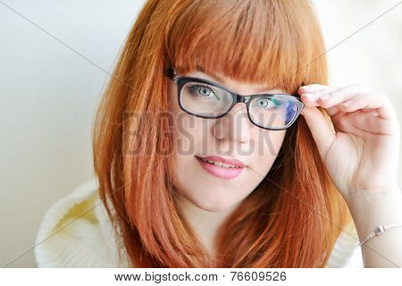 Caucasian Redhead Girl With Glasses