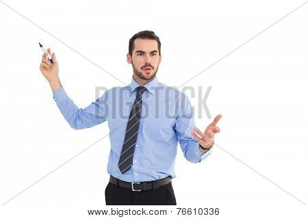 Businessman speaking and gesturing with marker on white background