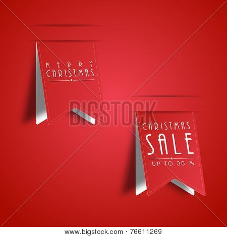 Merry Christmas and sale upto 30% text on paper cut design on red background.