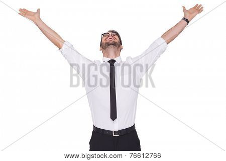Cheering businessman with his arms raised up on white background