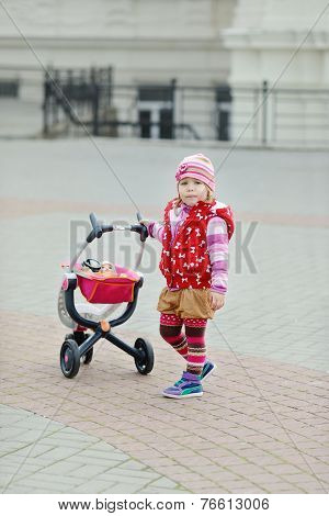 So Cute Toddler Girl With Toy Stroller