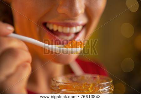 Closeup On Young Woman Eating Homemade Orange Jam