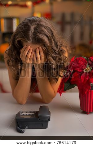 Stressed Young Housewife Near Phone In Christmas Decorated Kitch