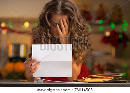 Closeup On Frustrated Young Housewife With Letter In Christmas D