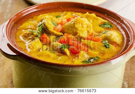 Curry In  A Bowl On A Wooden Table.